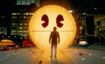 In Pixels, the world is in danger -- not from the aliens who are using video game icons to destroy us -- but by Adam Sandler trying to be funny.